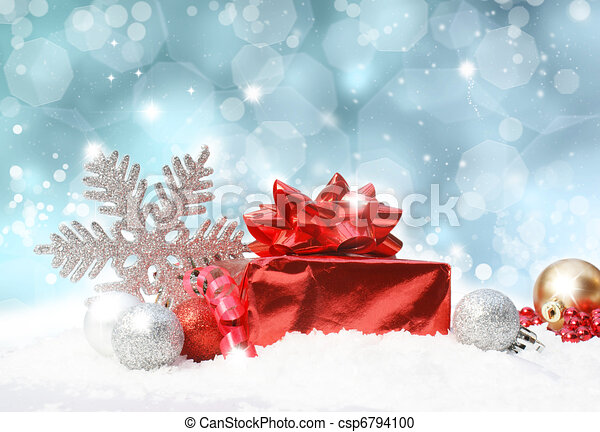 Christmas decorations on blue glittery background - csp6794100