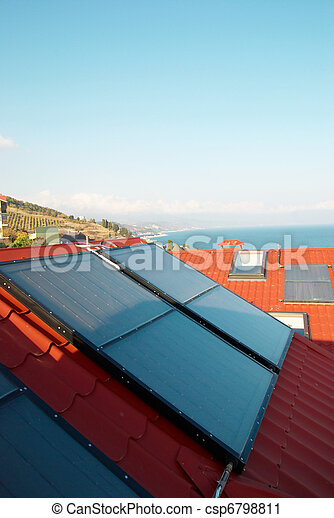 Alternative energy- solar system on the house roof. - csp6798811