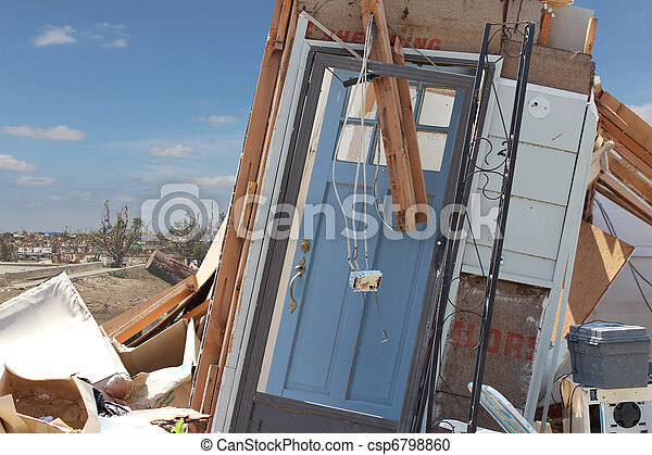 Tornado Damage Blue Front Door - csp6798860
