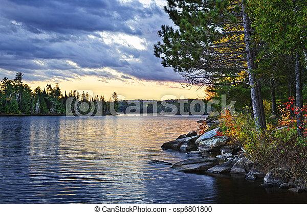 Dramatic sunset at lake - csp6801800