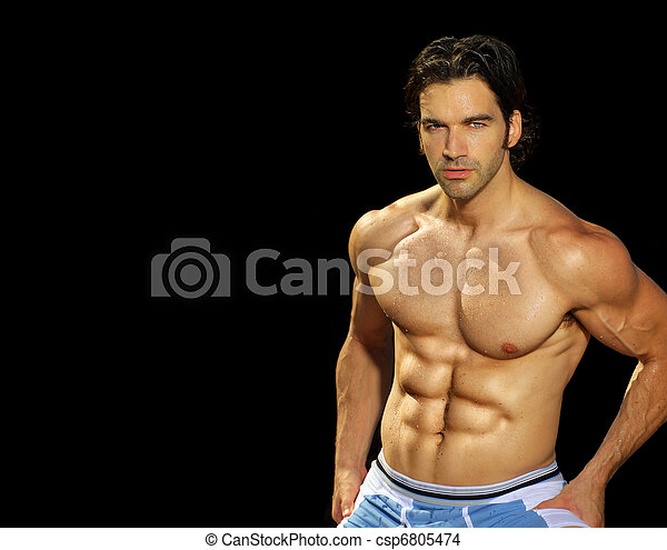 Male fitness model on black background - csp6805474