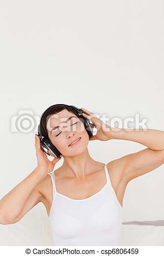 Charming woman listening to music - csp6806459