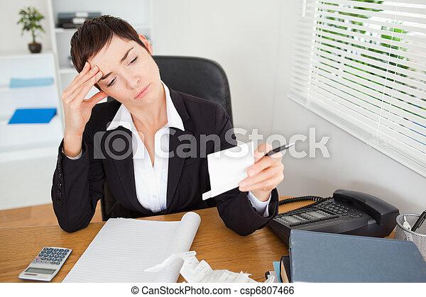 Unhappy accountant checking receipts