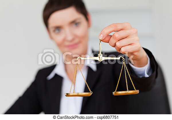 Serious businesswoman holding the justice scale - csp6807751