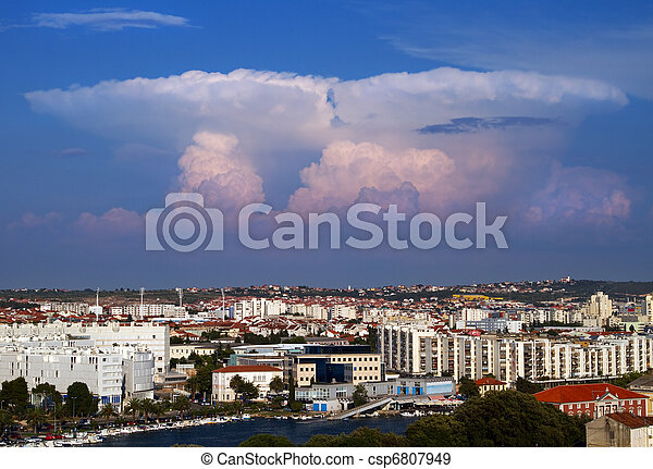 Towering cumulus over city. - csp6807949