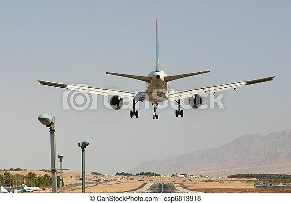 Passenger airplane before landing. - csp6813918