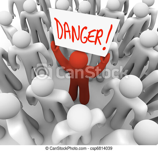 Danger - Person Holding Sign to Warn or Alert Others - csp6814039