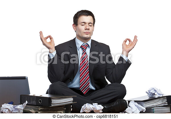 Stressed, frustrated business man meditates in office at desk - csp6818151