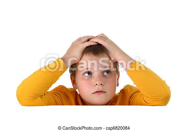 Small hopeless boy holding head - csp6820084