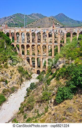 Old aqueduct in Nerja, Spain - csp6821224