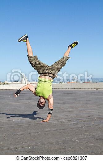 hip hop dancer dancing outdoors - csp6821307