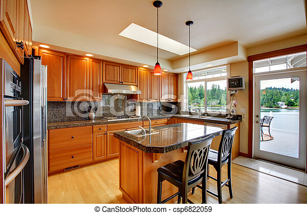 Beautiful kitchen with island, granite and hardwood floor - csp6822059