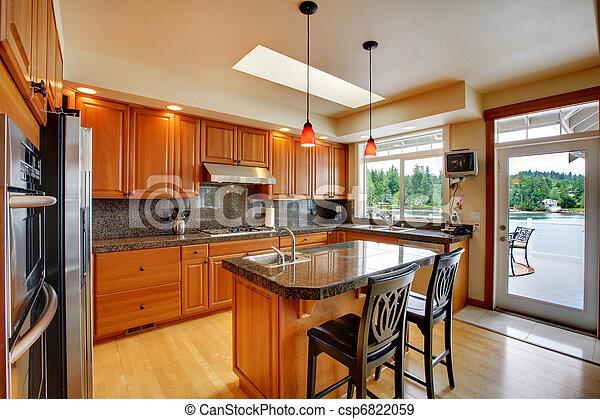 Beautiful kitchen with island, granite and hardwood floor - csp6822059