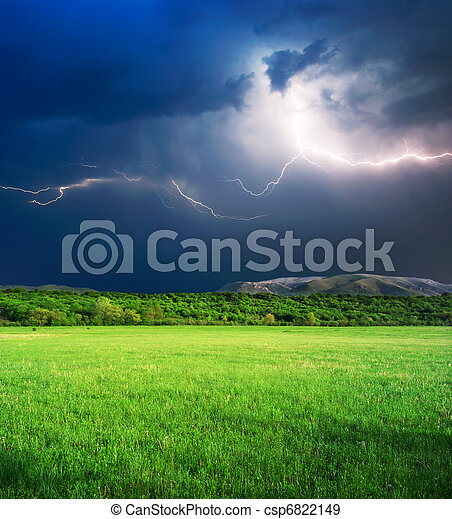 Thunderstorm in green meadow - csp6822149