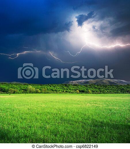 Thunderstorm in green meadow - csp6822149