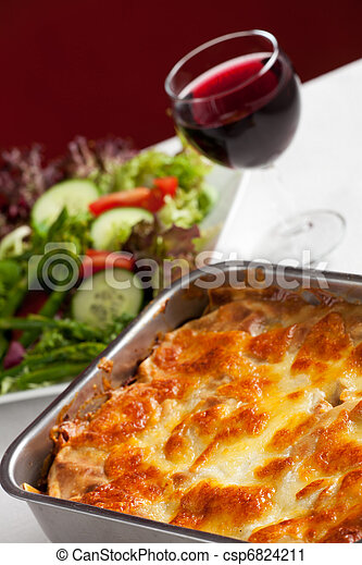 baking dish with lasagna and salad - csp6824211
