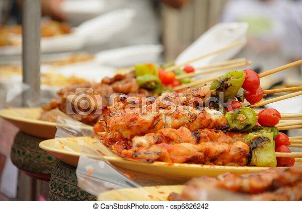 Thai cuisine barbecue chicken and pork skewers - csp6826242