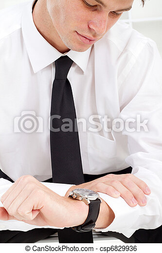 businessman looking at watch - csp6829936
