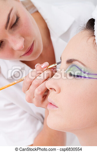 professional female makeup artist  - csp6830554