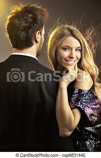 Portrait of a happy young smiling woman with her man - csp6831445
