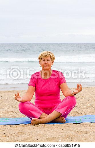 senior woman doing meditation - csp6831919