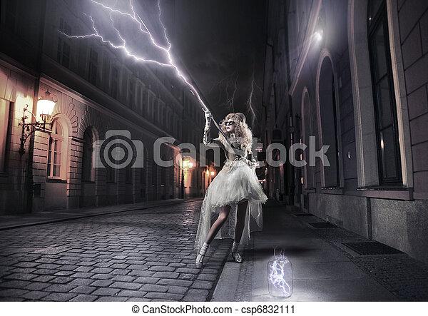 Stylish woman catching thunderbolts - csp6832111