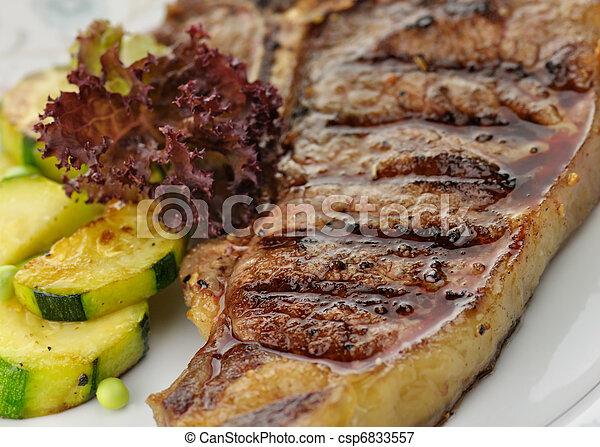 barbecue T Bone steak close up  - csp6833557