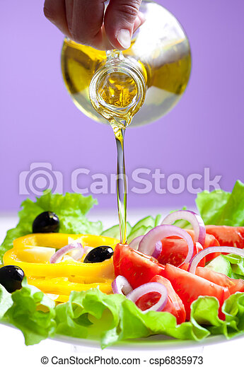 olive oil stream and healthy fresh vegetable salad - csp6835973