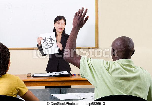 raising hand in chinese classroom - csp6836513