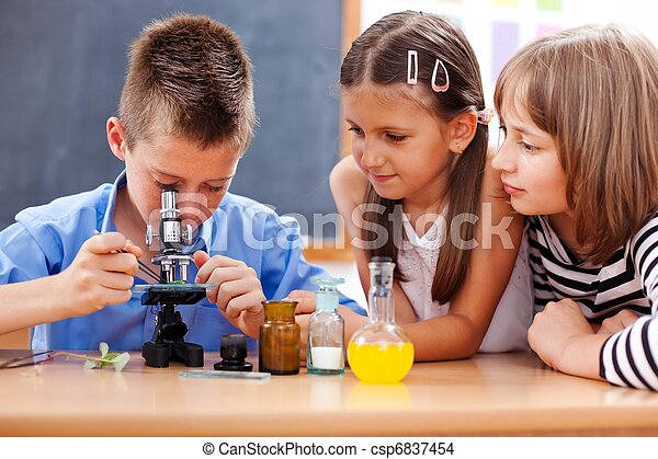 Boy looking into microscope - csp6837454