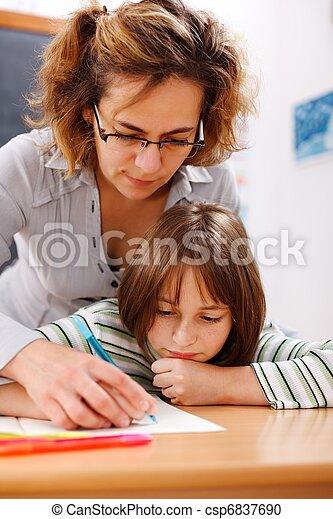 Teacher holding student\'s hand