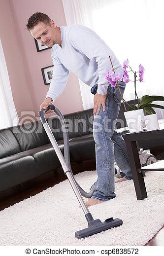 Living room cleaning vacuum cleaner. - csp6838572