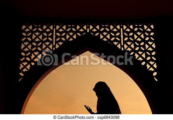 silhoutte of muslim woman praying  - csp6843098