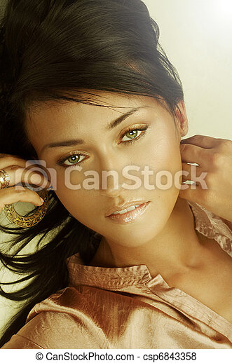 Sensual young adult woman with beautiful long brown hairs - csp6843358