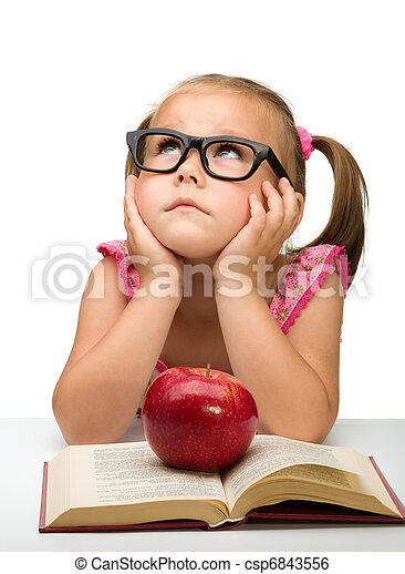 Little girl is sitting bored with a book - csp6843556