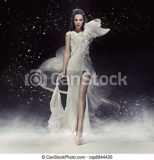 Beautiful brunette lady in white dress - csp6844430