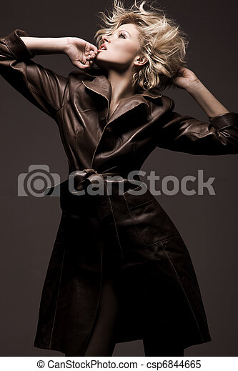 Photo of a beauty woman wearing coat - csp6844665