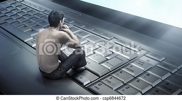 Conceptual photo of a young man addicted to the internet - csp6844672