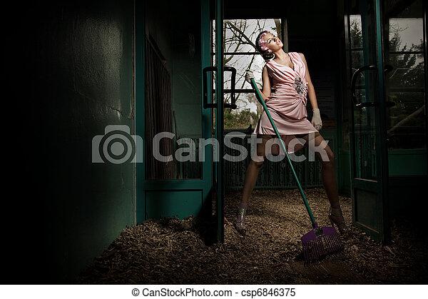 Young elegant woman with rake - csp6846375