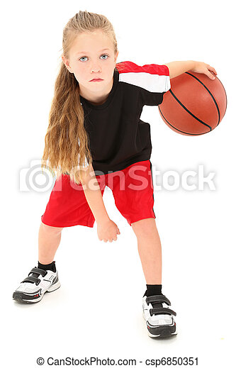 Serious girl child basketball player in uniform dribbling ball between legs over white background. - csp6850351