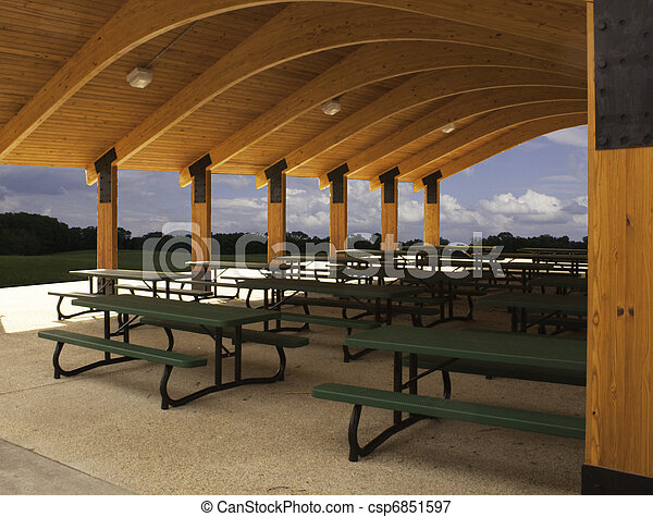 Picnic tables in outdoor pavilion - csp6851597