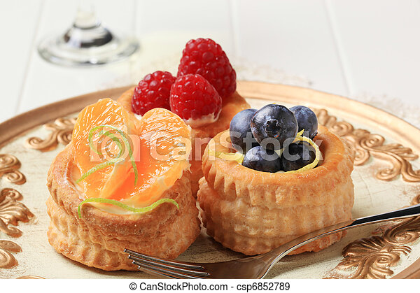 Puff pastries with custard and fruit - csp6852789