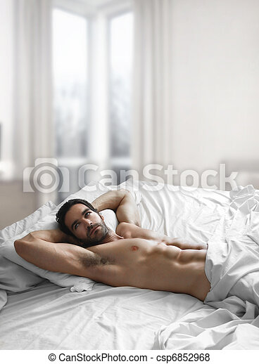 Sexy man in bed - csp6852968
