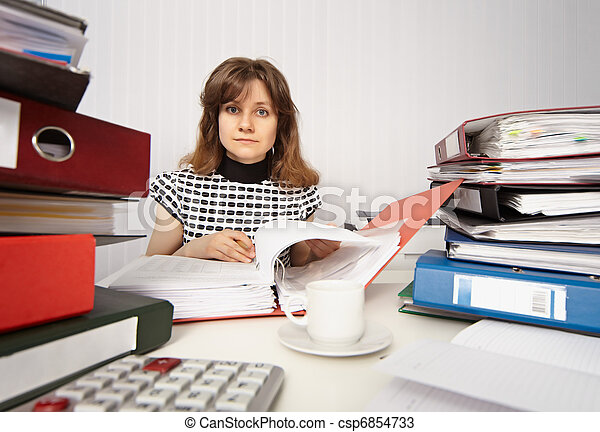 Female accountant very busy in office - csp6854733