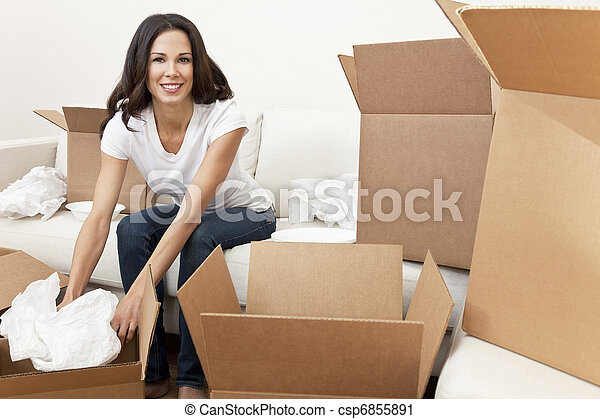 Single Woman Unpacking Boxes Moving House - csp6855891