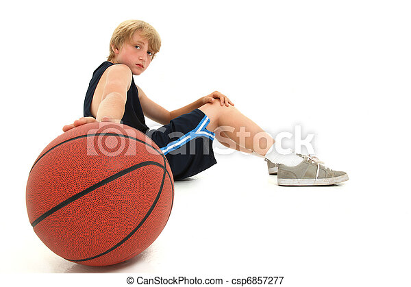 Teen Boy Child in Uniform Sitting with Basketball - csp6857277