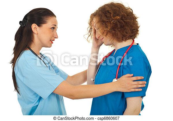Doctor comforting her colleague  - csp6860607