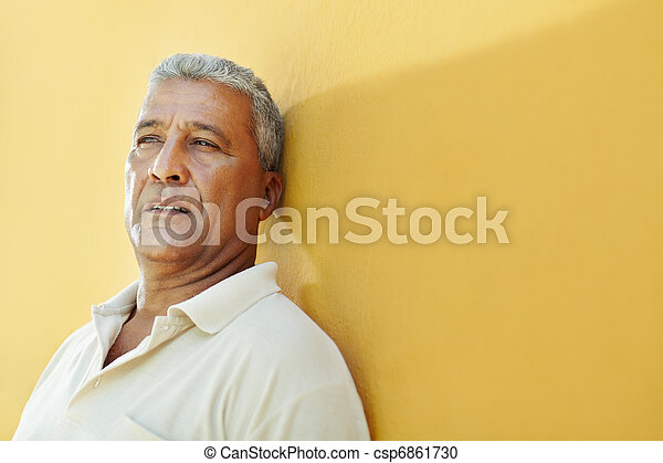 portrait of sad mature hispanic man - csp6861730