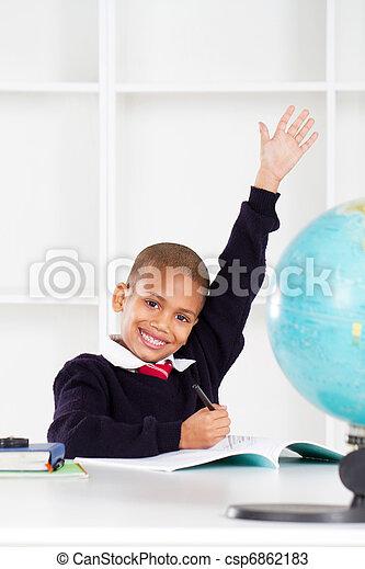 first grade student raising hand - csp6862183