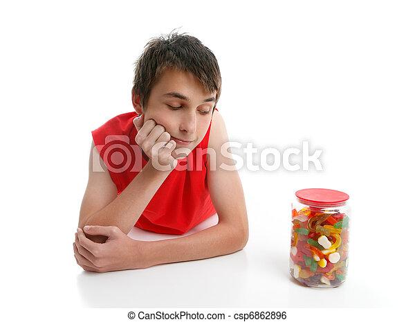 Boy ponders to open jar confectionery - csp6862896